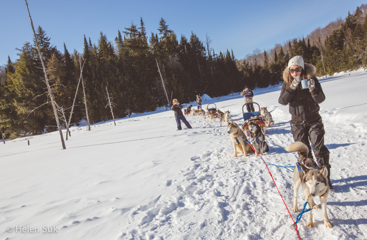 people taking a hot chocolate break during a winterdance dog sled ride