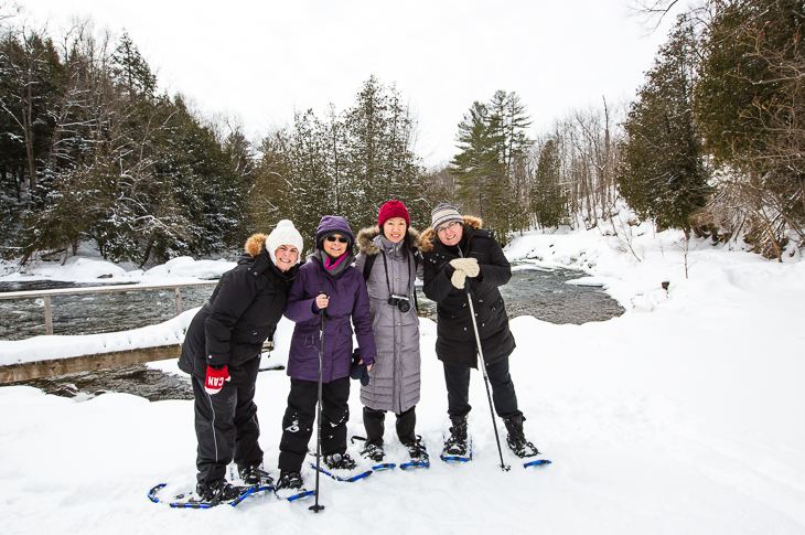 group of women snowshoeing in ontario