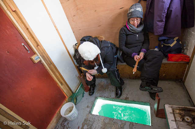 women in ice fishing hut