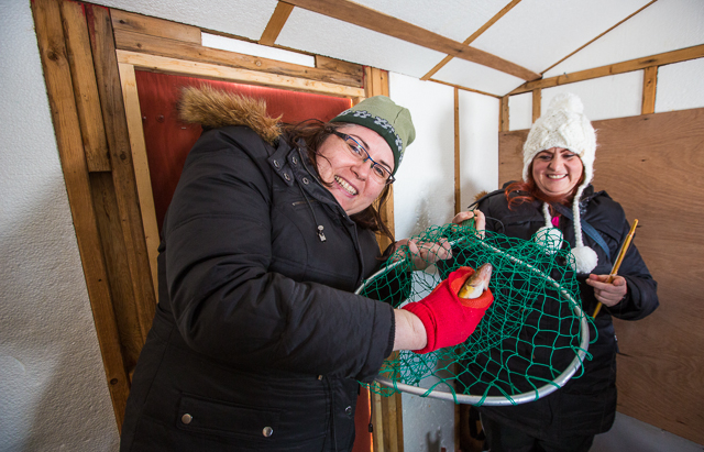 ice fishing women with their catch