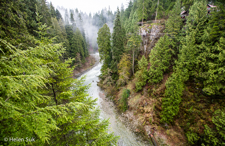 view of the river from the suspension bridge at capilano suspension bridge park