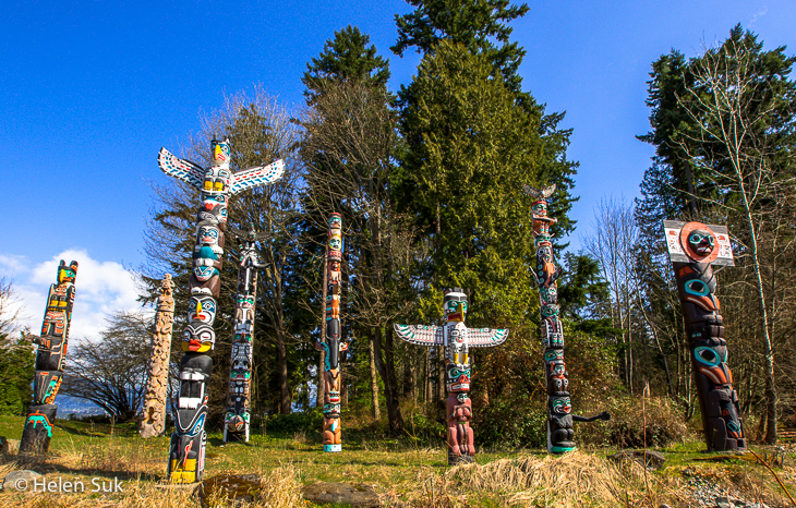native totem poles at brockton point in stanley park vancouver