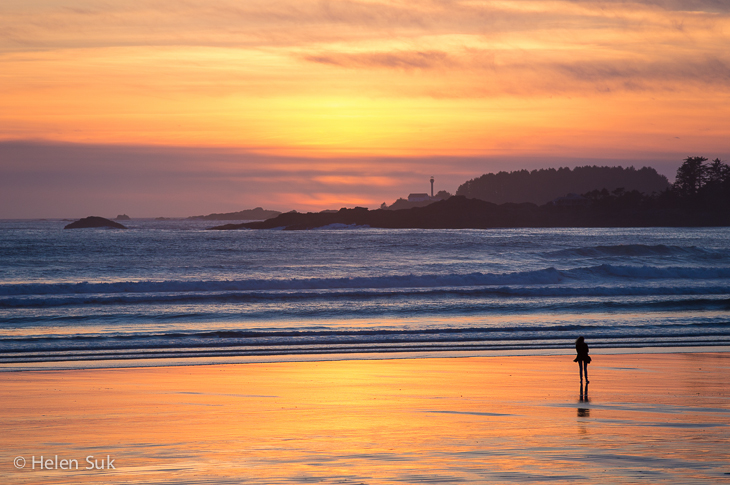 silhouette of a woman watching the sunset in tofino