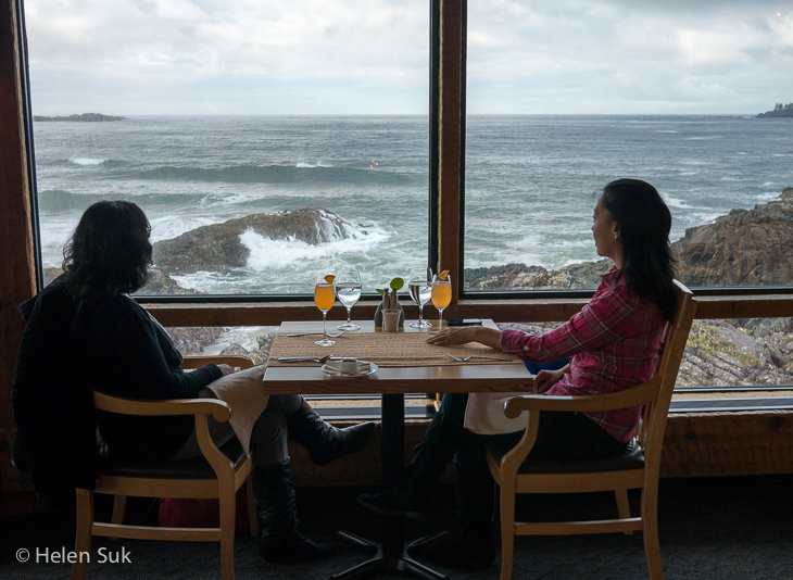 two women overlook the ocean at the pointe restaurant at the wickaninnish inn in tofino bc