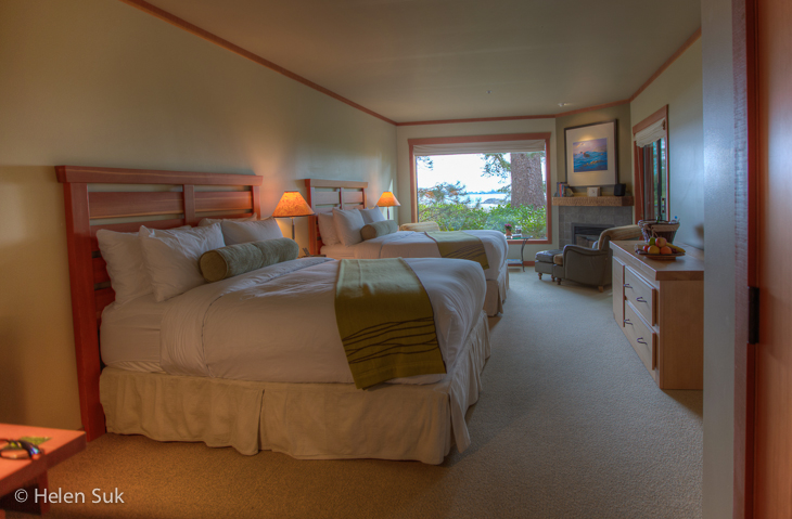 room with two beds at the wickaninnish inn, one of the best tofino hotels