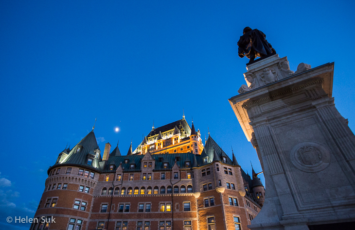 chateau frontenac hotel and champlain monument at dusk in quebec city