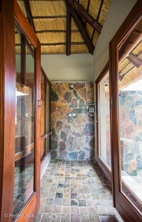 indoor shower in the luxury suite at arathusa safari lodge