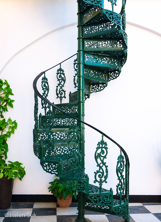 ornate staircase in stone town hotel