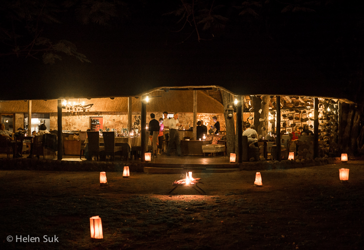 candle lit outdoor lounge by night at motswari private game reserve