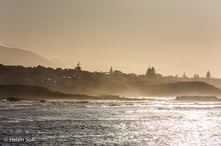 misty landscape of ocean and mountain at seivers punt hermanus