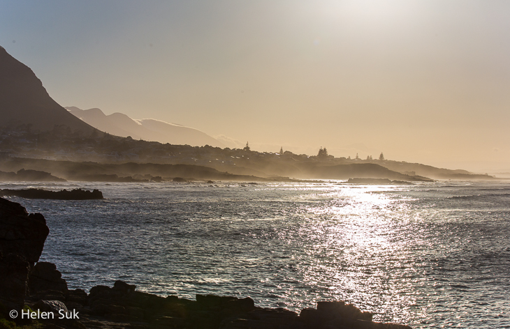 misty morning on the edge of the ocean at seiver's punt hermanus