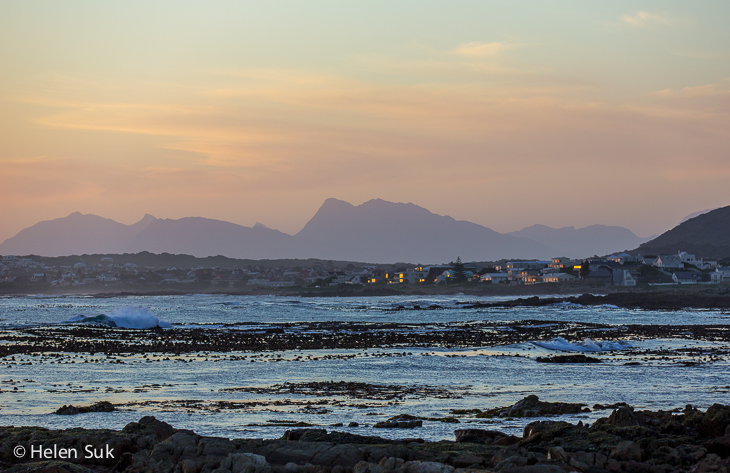 view of hermanus at twilight with mountains and pink and blue sky