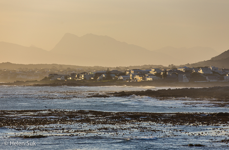 scenic view of ocean and mountains in sandbaai hermanus