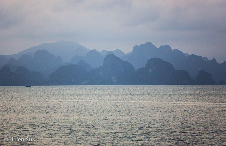 islands in halong bay at dusk