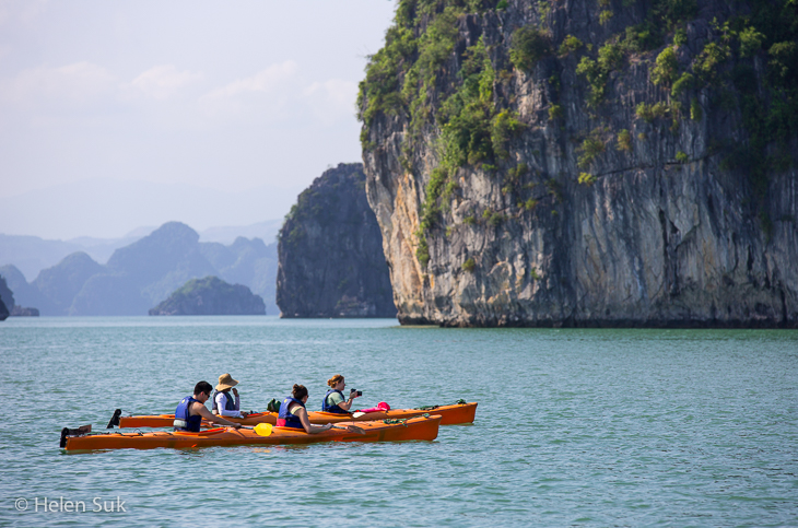 tourists sea kayaking in ha long bay vietnam