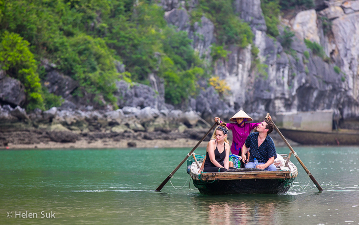 vietnamese women driving a boat with passengers in bai tu long bay