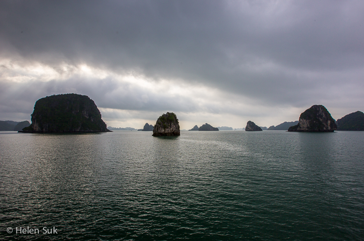 dark and moody scene in halong bay with islets across halong bay