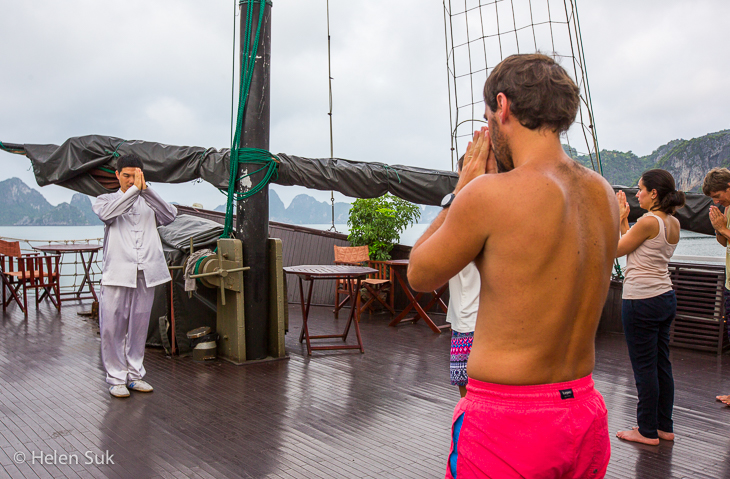 treasure junk passengers partake in a tai chi class on the top deck
