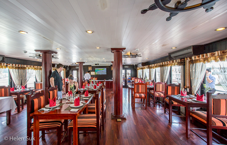 bright dining area on the treasure junk boat in halong bay