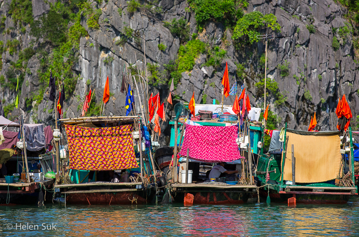 house boats floating in vung vieng village in bai tu long bay vietnam