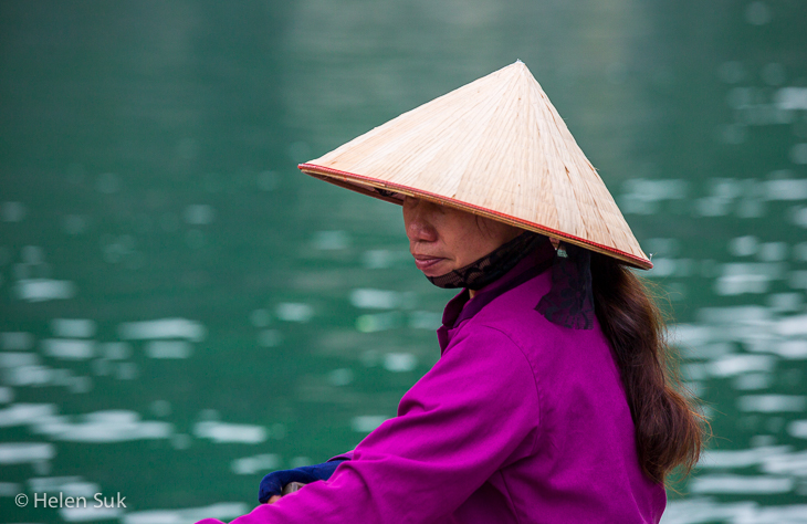 side profile of a vietnamese woman on a boat in ha long bay vietnam