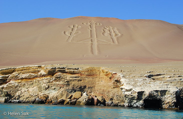 candelabra etched in a sand dune at the ballestas islands peru