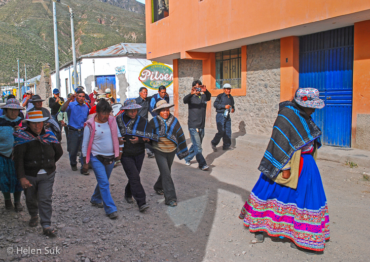 locals walk through the town of chivay peru
