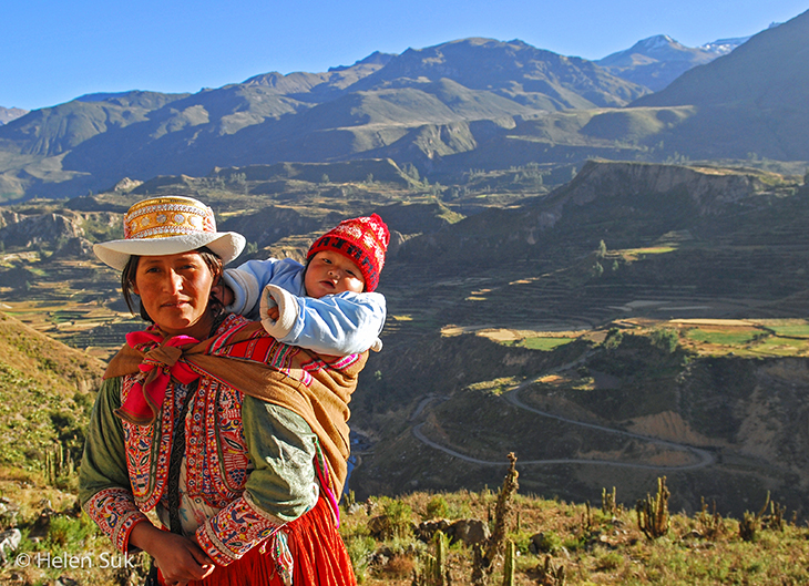 peruvian woman with child in colca valley peru