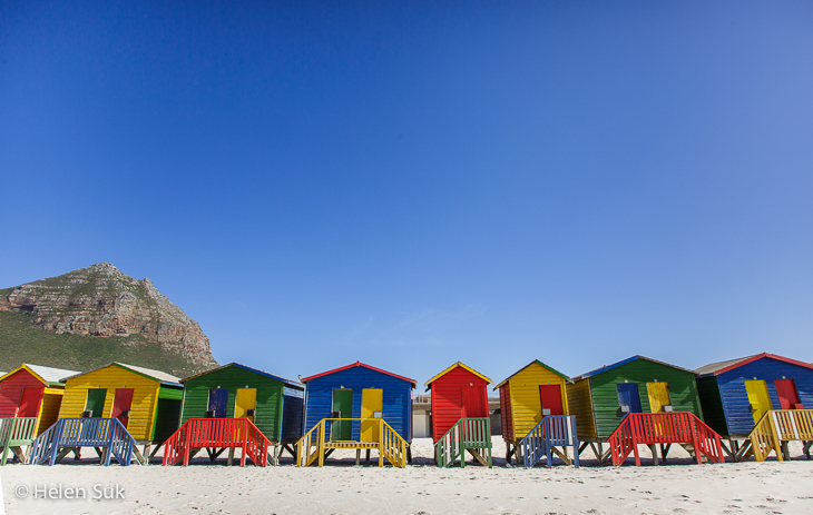 line of colourful beach houses at muizenberg beach