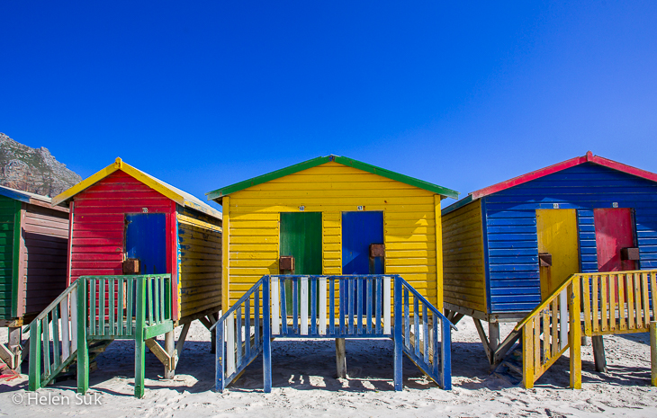three vibrant multicoloured beach houses muizenberg beach