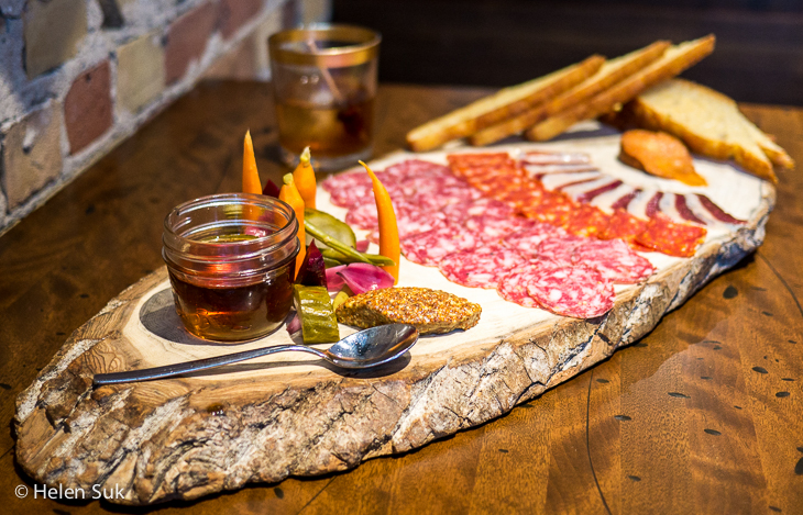 charcuterie plate with smoked maple syrup at parlor foods restaurant toronto
