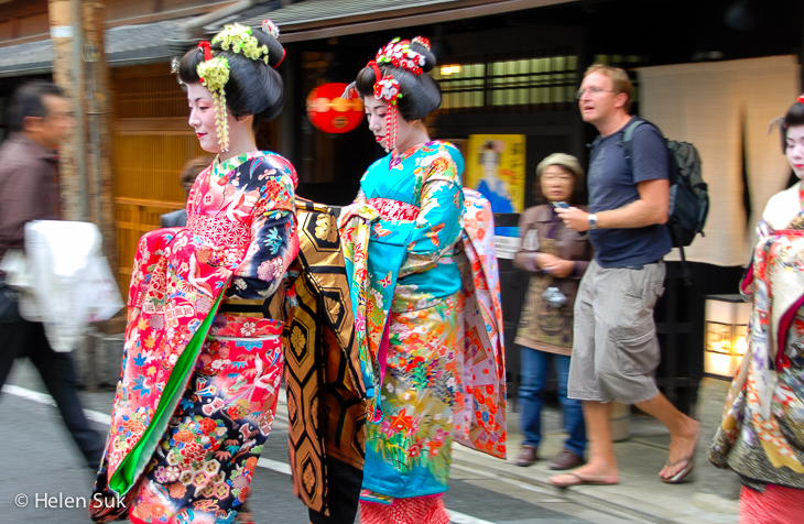 elaborately dressed geisha women walking the streets of gion japan
