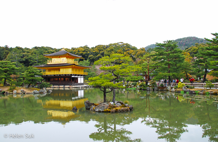 golden pavilion surrounded by a lake at kinkaku-ji in kyoto japan