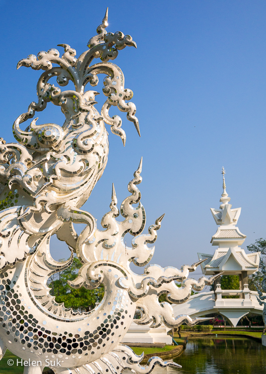 sculpture at the white temple in chiang rai
