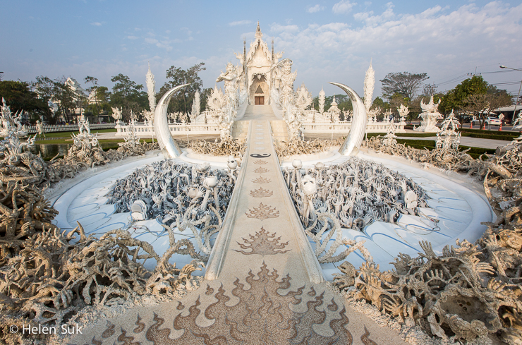 wide angle shot of the white temple in thailand