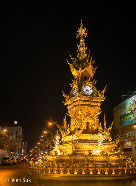chiang rai clock tower lit up at night