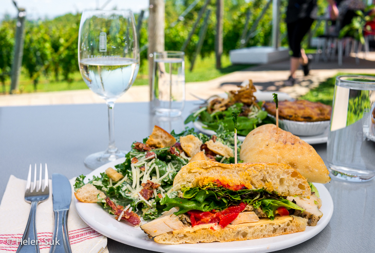 sandwich and glass of white wine at luckett vineyards